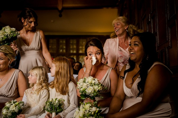 Bridesmaid wiping away tear - Picture by Steve Grogan Photography