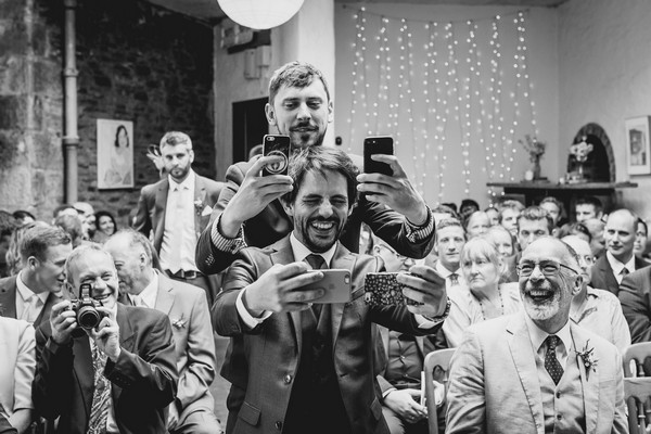 Groom and best man taking selfies at wedding ceremony - Picture by Alexa Poppe Wedding Photography