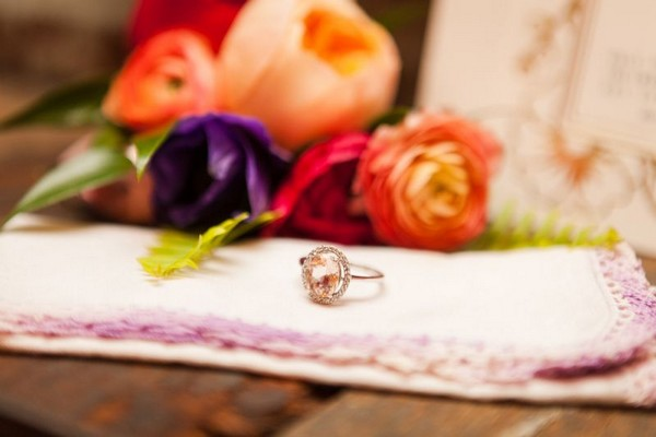 Wedding ring next to colourful flowers