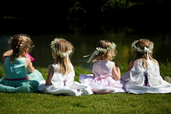 Flower girls sitting on grass