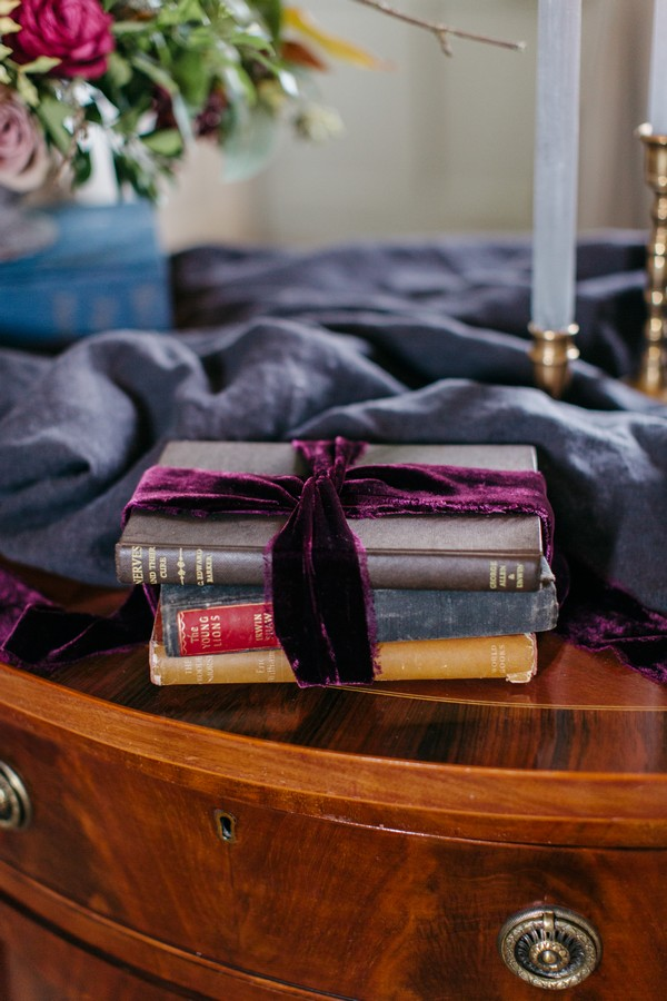 Old books wrapped in purple bow