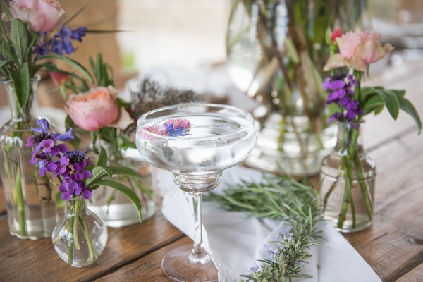 Cocktail and vases of flowers