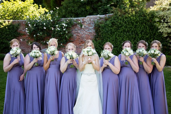 Bride with bridesmaids wearing lavender dresses