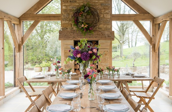 Long rustic table with homegrown flower styling