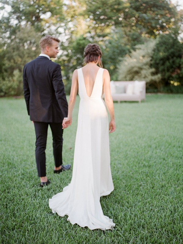 Bride and groom walking in garden of Barr Mansion in Austin, Texas