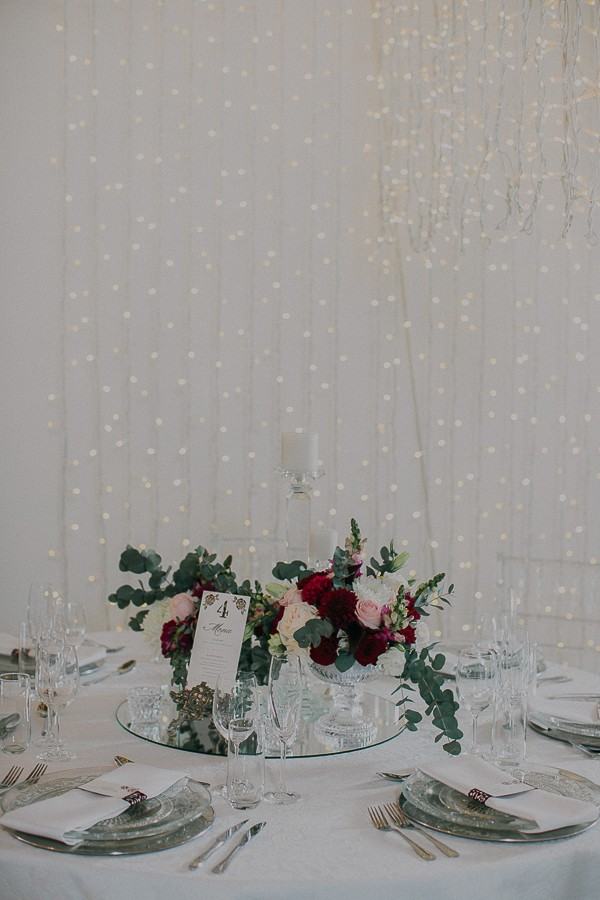 Wedding table with winter floral centrepiece