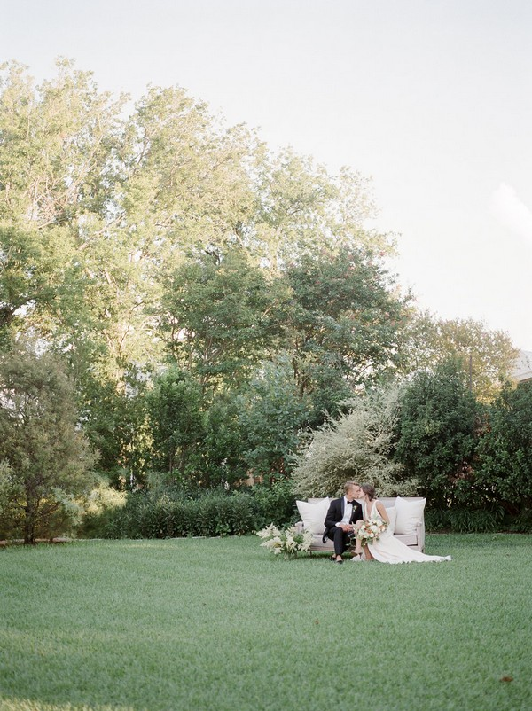 Bride and groom sitting in garden of Barr Mansion in Austin, Texas