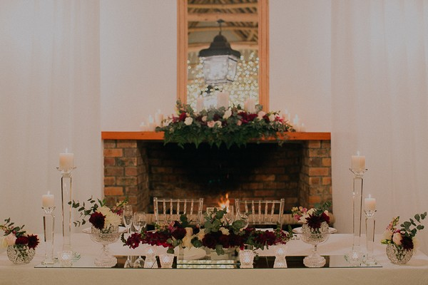 Wedding top table in front of fireplace