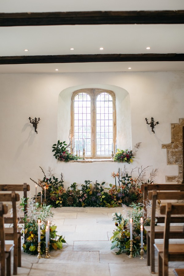 Wedding ceremony room in Castle House at Brympton House dressed with flowers