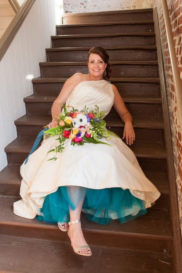 Bride leaning back on stairs