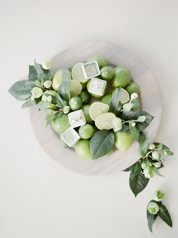 Wedding rings in bowl of limes