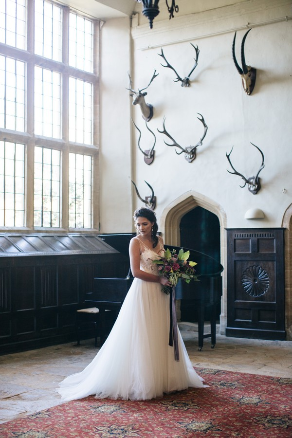 Bride holding bouquet in Brympton House