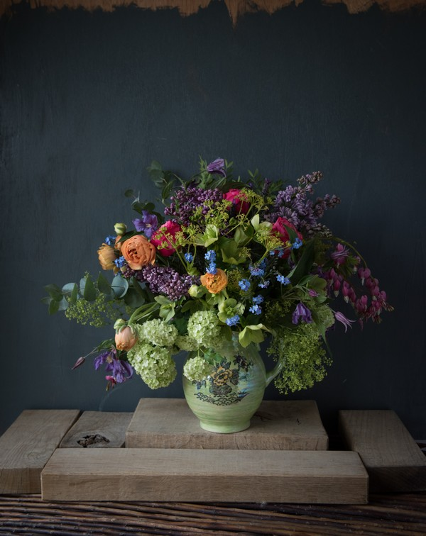 Vase of colourful homegrown flowers