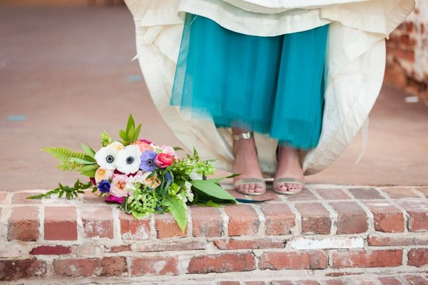 Bridal bouquet and bride's teal underskirt