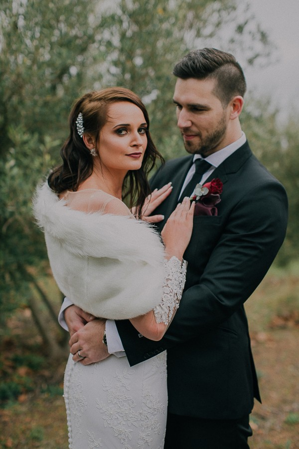 Bride in fur shrug with groom