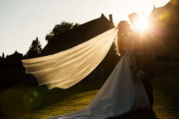 Sun shining through bride's veil