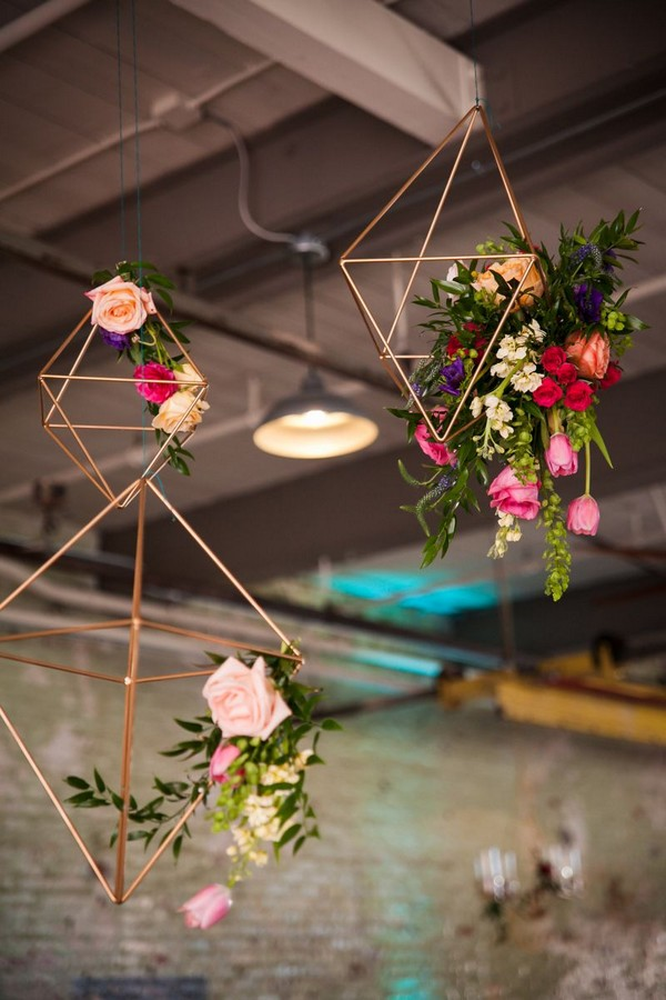 Geometric shapes with flowers hanging from ceiling