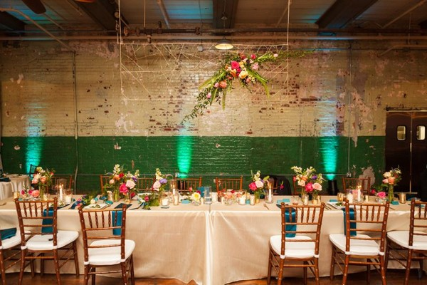 Wedding top table with hanging floral installation above