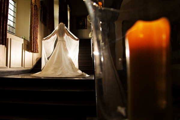 Bride holding out veil