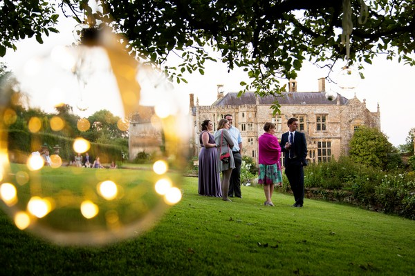 Wedding guests in grounds of Brympton House