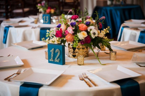 Colourful floral wedding table centrepiece