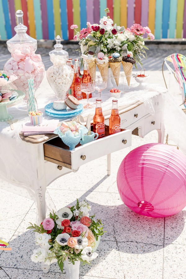 Table of colourful sweets and ice cream for hen party