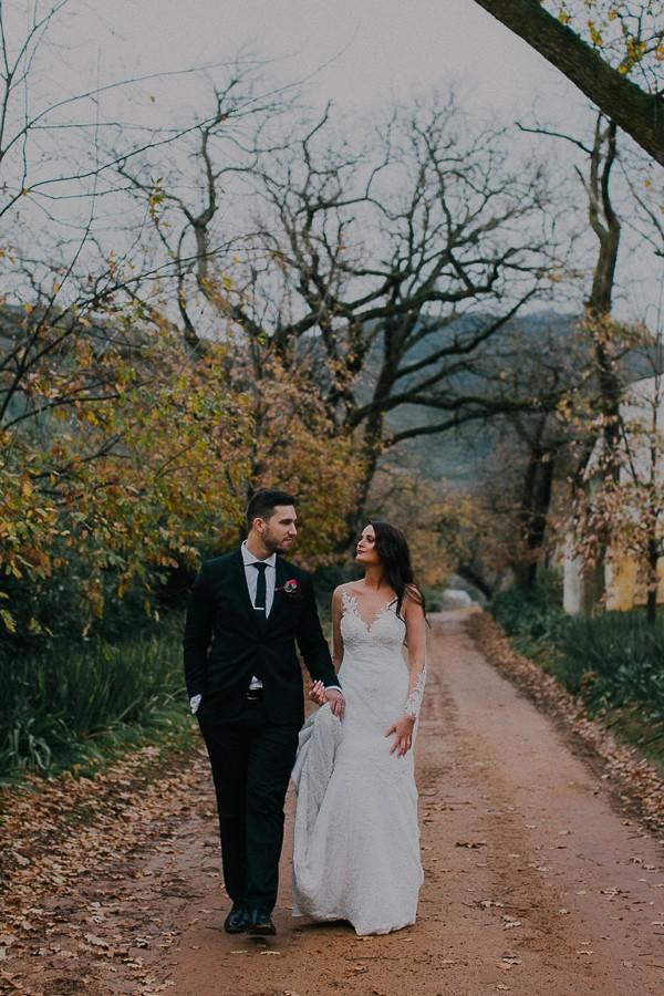 Bride and groom walking through Vondeling vineyard