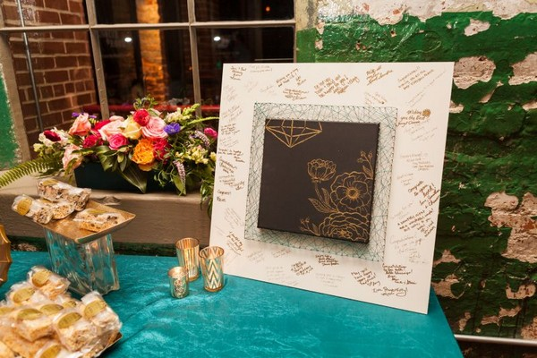 Wedding guest book with gold flowers drawn on