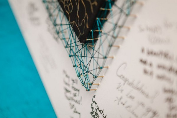 String art around wedding guest book