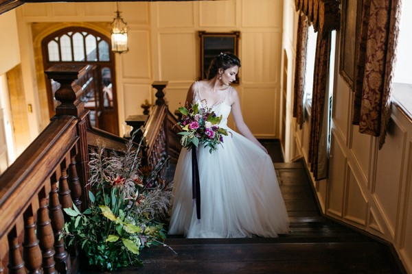 Bride on stairs at Brympton House