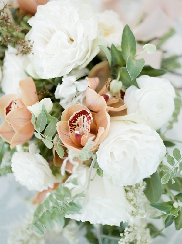 Peach and white flowers of bridal bouquet