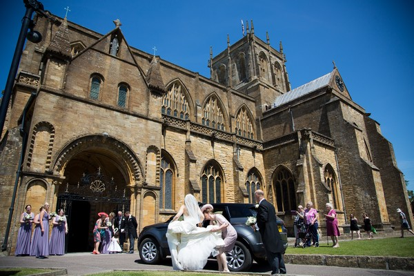 Bride arriving at Sherborne Abbey for wedding ceremony