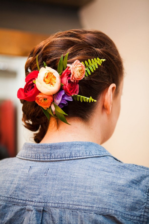 Colourful flowers in back of bride's hair
