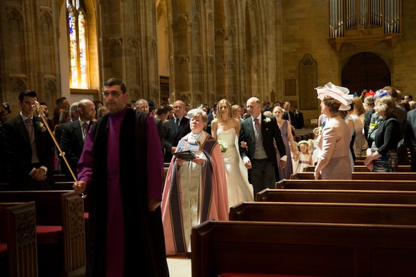 Bride and father following minister down the aisle