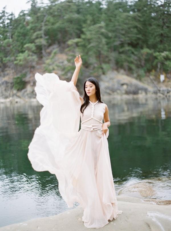 Bride lifting wedding dress