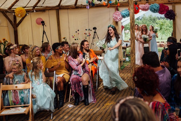 Bridesmaid Dancing Down Wedding Aisle