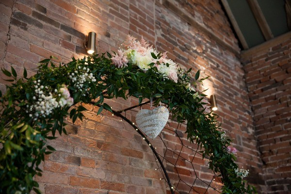 Wedding Ceremony Arch of Foliage and Flowers
