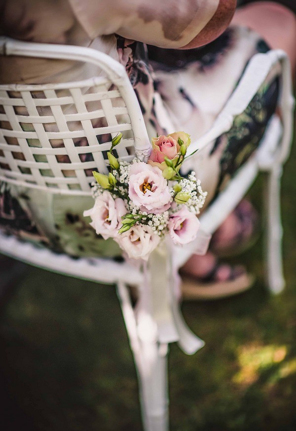 Flowers Tied to Wedding Chair