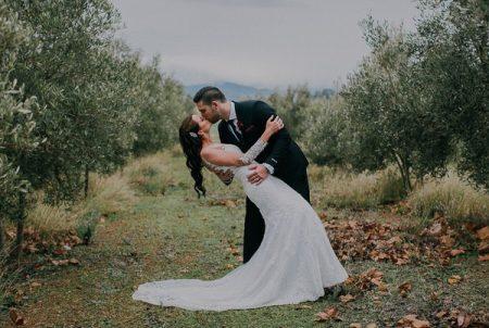 Bride and groom kissing at Vondeling vineyard
