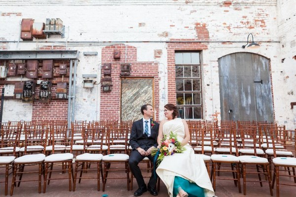 Bride and groom sitting on wedding ceremony chairs at The Engine Room in Georgia
