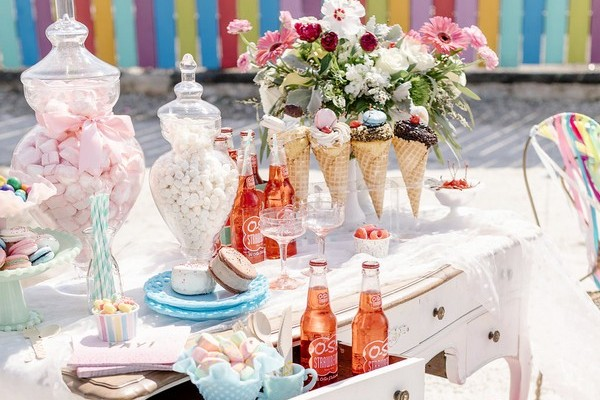 Table with ice cream and sweet treats for hen party