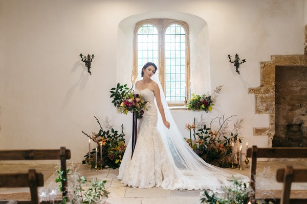 Bride holding bouquet in ceremony room at Brumpton House