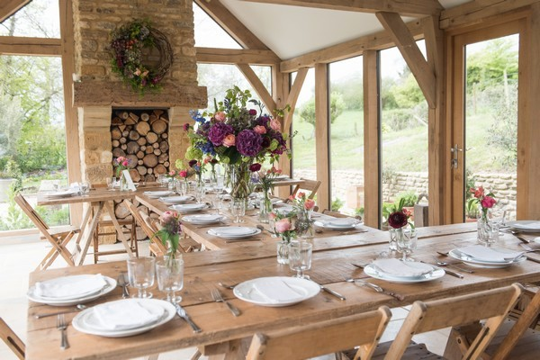 Rustic wedding tables with homegrown flower displays