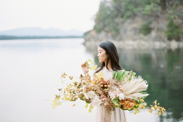 Bride holding large foraged bridal bouquet