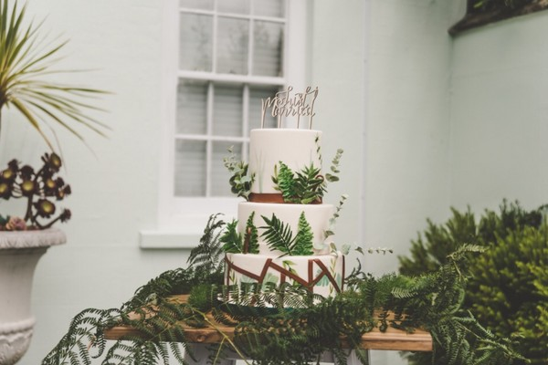 Wedding cake by Claire's Sweet Temptations covered in fern