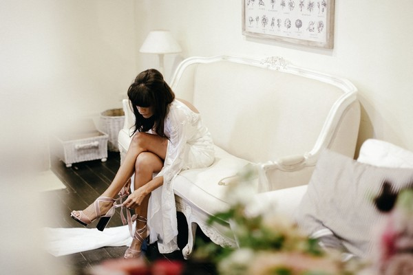 Bride putting bridal shoes on