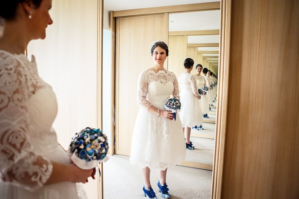 Bride looking at herself in mirror