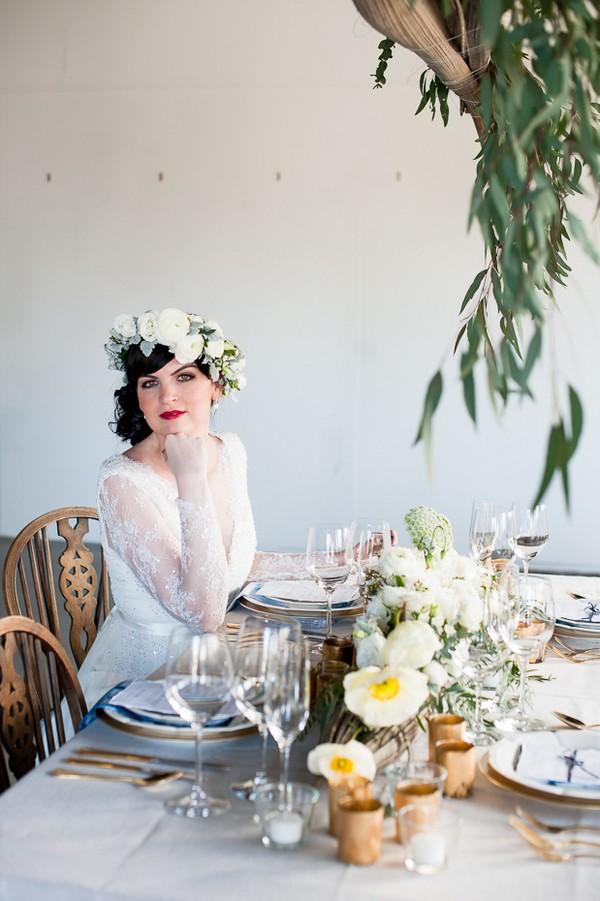 Bride sitting at elegant wedding table