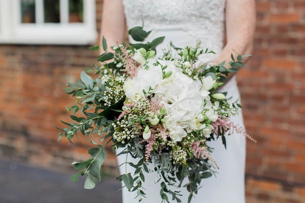 Bridal bouquet with white flowers and foliage