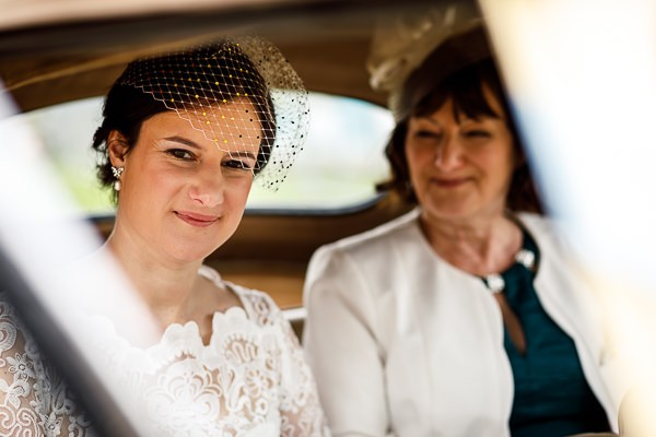Bride and mother in back of wedding car